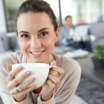 Woman drinking hot tea — Stock Photo #36645595