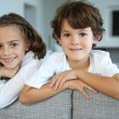 Brother and sister on sofa — Stock Photo #36646253