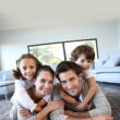 Family on carpet — Stock Photo #36646297