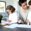 Daddy with kids drawing — Stock Photo