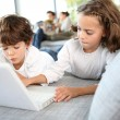 Kids playing with laptop — Stock Photo