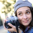 Girl holding camera — Stock Photo