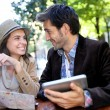 Tourists in coffee shop table — Stock Photo