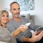 Couple watching tv — Stock Photo #36647639