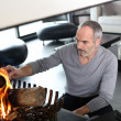 Stock Photo: Mature mpreparing fire