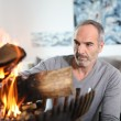 Man preparing fire — Stock Photo