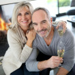 Senior couple with champagne — Stock Photo #36647829