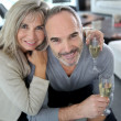 Senior couple with champagne — Stock Photo #36647839