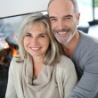 Senior couple enjoying fireplace — Stock Photo
