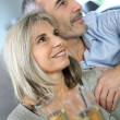 Couple celebrating with champaign — Stockfoto