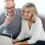 Senior couple and financial adviser — Stock Photo