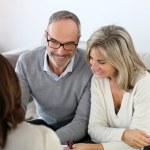 Senior couple meeting financial adviser — Stock Photo