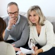 Stock Photo: Couple meeting financial adviser