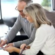 Couple signing real-estate contract — Stock Photo #36648041