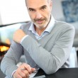 Mature businessman working at home — Stock Photo