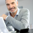 Mature man working with laptop — Stock Photo