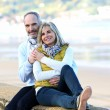 Stock Photo: Couple by beach