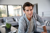 Man sitting in living-room — Stock Photo