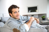 Man in front of tv set — Stock Photo