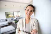 Smiling woman in living-room — Stock Photo
