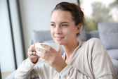 Smiling woman with cup of tea — Stock Photo
