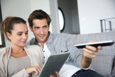 Couple looking for tv program — Stock Photo