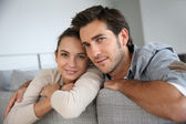 Cheerful couple at home — Stock Photo
