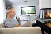 Senior man reading newspaper — Stock Photo
