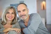Smiling senior couple at home — Stock Photo