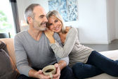 Senior couple on couch — Stock Photo