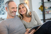 Couple with tablet — Foto Stock