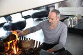 Mature man preparing fire — Foto Stock