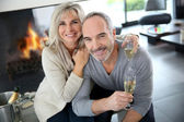 Senior couple with champagne — Stock Photo