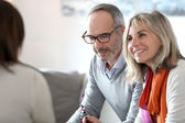 Senior couple meeting financial adviser — Stock Photo