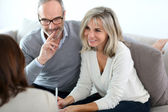 Senior couple and financial adviser — Stock Photo