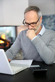 Mature man working with laptop — Foto Stock