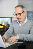 Man working from home with laptop — Stock Photo