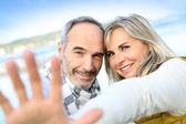 Сouple showing hands towards camera — Stock Photo
