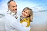 Senior couple on beach — Stock Photo