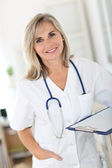 Smiling senior nurse — Stock Photo