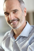 Handsome businessman with grey hair — Stock Photo