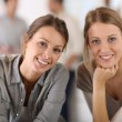 Smiling girls in office — Stock Photo
