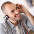 Smiling man listening music — Stock Photo