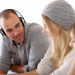 Stock Photo: Friends listening music