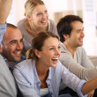 Smiling friends watching football — Stock Photo