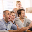 Group of friends watching football — Stock Photo