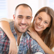 Happy couple sitting at home — Stock Photo