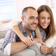 Sweet couple on sofa — Stock Photo