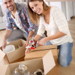 Happy adults moving in new home — Stock Photo