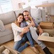 Happy couple in new home — Stock Photo